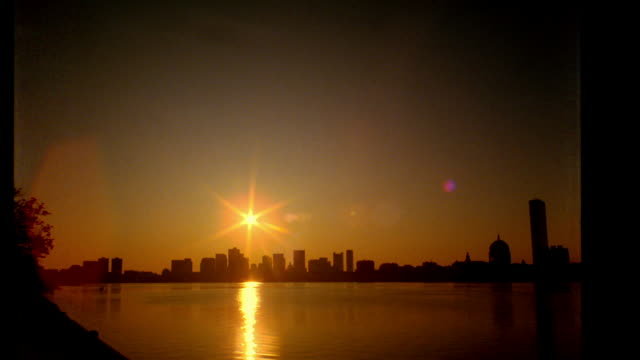 wide shot time lapse sun rising over skyline / Boston, MA
