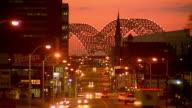 Wide shot time lapse traffic on street at dusk / Memphis