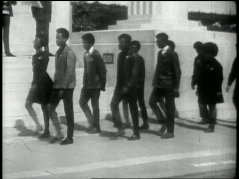 1969 wide shot tracking shot Black Panthers marching outside Alameda County Courthouse / Oakland CA