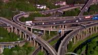 Wide shot Traffic driving on Spaghetti Junction overpass/ Birmingham, England