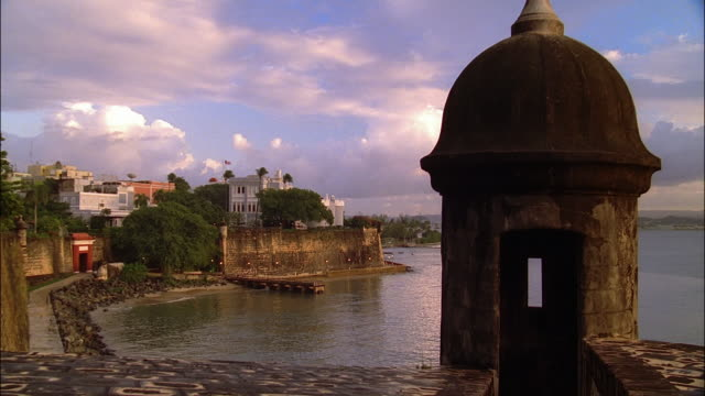 Wide shot view from behind sentry tower of city wall at San Juan Harbor / Old San Juan, Puerto Rico