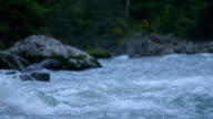 wide shot: wild river in the mountains - slow motion