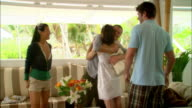 Wide shot Young couples greeting each other in hotel during vacation/ Harbor Island, Bahamas