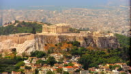 Wide shot zoom out from Parthenon on Arcropolis to cityscape of Athens / Greece