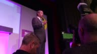 Wide shots of Nigel Farage leader of the UK Independence Party speaking during his address to delegates at his political party's Spring conference at...