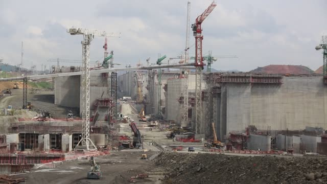Wide shots of the new set of locks for the Panama Canal under construction in Panama Central America Shots pan up and down the large concrete walls...