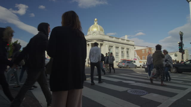 Wide time lapse shot of pedestrians in city intersection / Washington D.C., District of Columbia, United States