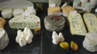 CU DS HA wide variety of cheeses arranged on a buffet