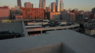 Wide View Of A City From The Top Of A Parking Garage At Sunset