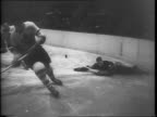 Wide view of the New York Rangers versus the Toronto Maple Leafs in the Stanley Cup World Series Playoffs in Madison Square Garden / a competing...