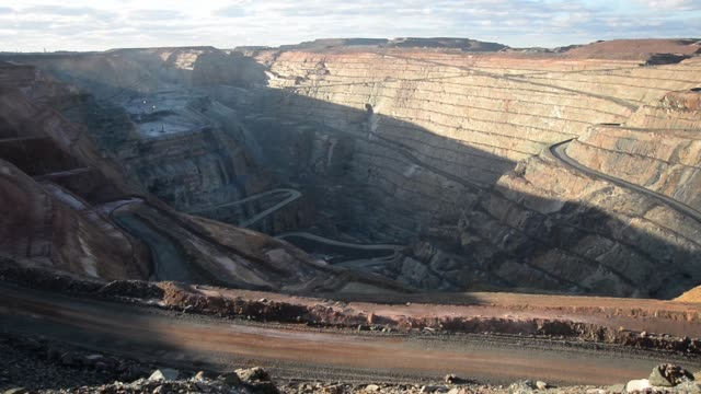 Wide view the Fimiston Open Pit also known as the Super Pit in Kalgoorlie Australia on Monday Aug 5 PAN RL Wide shot Super Pit Fast pull out from...