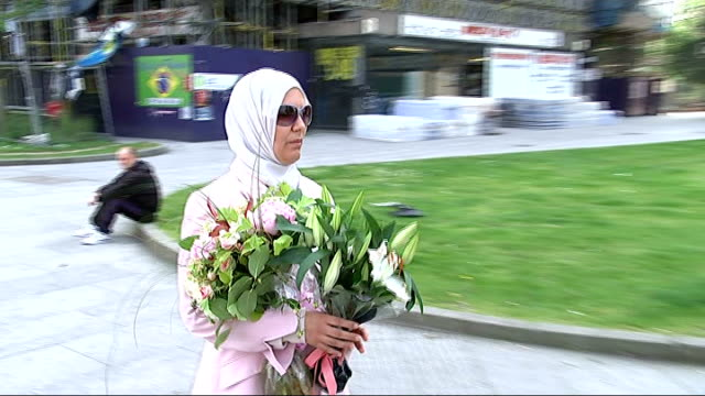 Widow of cyclist calls Elephant and Castle roundabout 'deathtrap' ENGLAND London Elephant and Castle EXT Fatima Malah along and laying floral tribute...