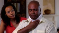 Wife Comforting Injured Husband in Neck brace