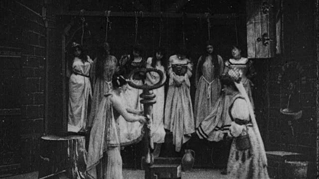 1901 B/W Wife dreaming of bodies of women she discovered in locked room, while the jester dances around