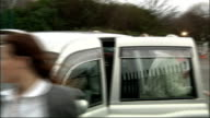 WikiLeaks founder Julian Assange leaving house Belmarsh Magistrates' Court Silver taxi along by police road check / Assange and others out of silver...