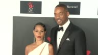 Will Smith and Jada Pinkett Smith at the 2nd Annual Diamond Ball at Barker Hangar on December 10 2015 in Santa Monica California