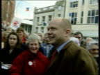 William Hague dismisses polls/Agrees to TV debate LIB Great Yarmouth People holding 'Keep the Pound' signs at rally Hague along thru crowd to stage...
