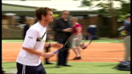 Andy Murray withdraws with wrist injury R13060702 ENGLAND London Raynes Park EXT Andy Murray gently hitting tennis ball in practice session with...