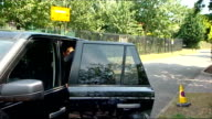 Fourth Round Andy Murray arrival ENGLAND London Wimbledon All England Club EXT Andy Murray out of car as collects kit from back of car / Murray along...