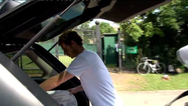 day nine Men's quarterfinals day various arrivals at All England Club Andy Murray arriving in car at tennis club Murray out from car and along to...