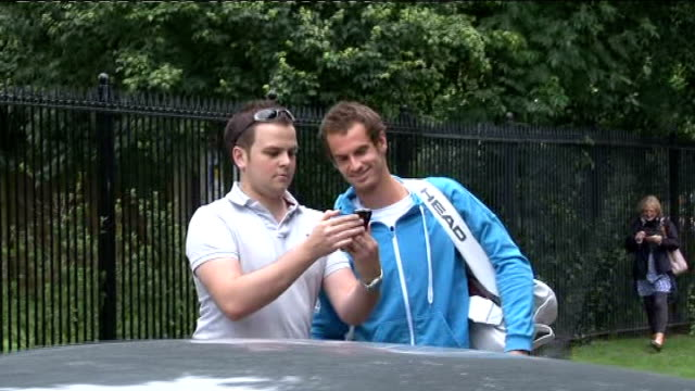 Heather Watson defeated by Agnieszka Radwanska Andy Murray standing with fan for photograph as he arrives at All England club