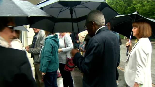 Celebrity arrivals ENGLAND London Wimbledon EXT Andrew Strauss along Andrew Strauss interview SOT Sir Trevor McDonald along holding umbrella / Andy...