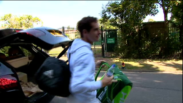 Andy Murray Arrival ENGLAND London Wimbledon All England Lawn Tennis Club EXT Andy Murray getting out of car gets gear from boot as chats to unseen...