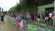 Increased security / Duchess of Cambridge visit / highlights ENGLAND London Wimbledon EXT GVs Fan queuing outside Wimbledon Andy Murray arriving in...