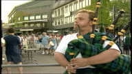 Andy Murray beaten in fourth round DAY Piper playing lament on bagpipes outside Centre Court