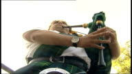 Andy Murray beaten in fourth round Low Angle Piper playing lament on bagpipes SOT