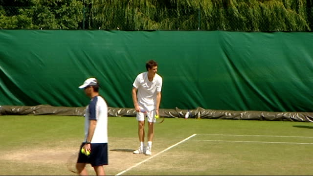 Andy Murray prepares for game against Fabrice Santoro Murray serving and receiving