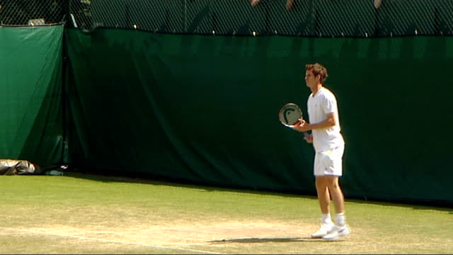 Andy Murray prepares for game against Fabrice Santoro Murray playing on practice court / Murray talking to coaches and practice partner during break...