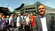 Andy Murray wins first round match Wimbledon Andy Murray wins first round match Fans queuing PAN to reporter to camera