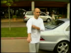 First day interrupted by rain ITN Andre Agassi along from car to sign autographs outside club