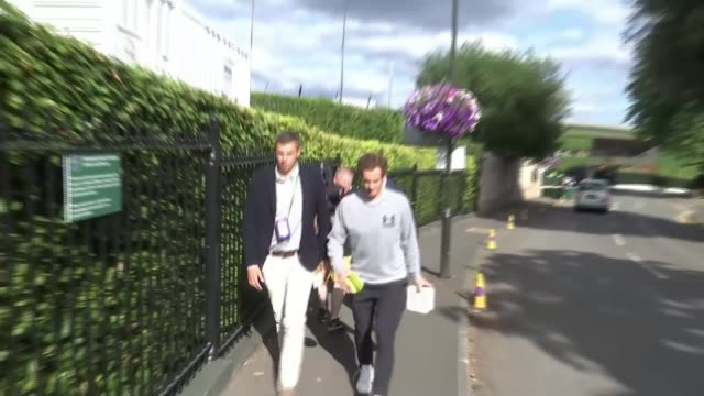 Murray loses to Querrey in quarter finals Wimbledon EXT Murray limping as walking along