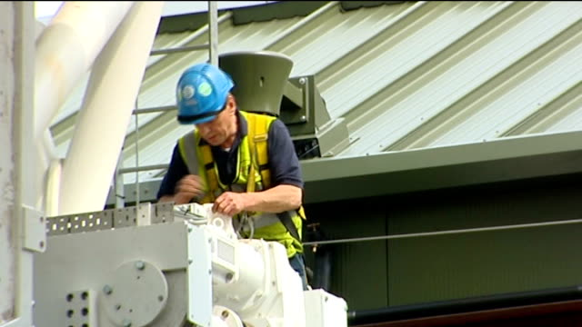 New roof on Centre Court Surveyors working at Centre Court / Workman on roof of court / workers on roof
