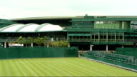 Henman and Borg interview ENGLAND London Wimbledon All England Lawn Tennis and Croquest Club EXT Groundstaff preparing court at the All England Club...