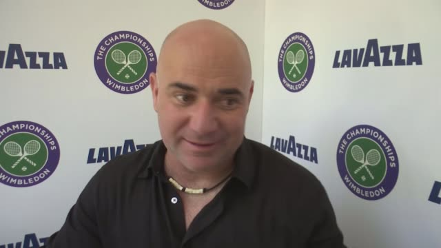 Wins for Johanna Konta and Andy Murray All England Lawn Tennis Club INT Andre Agassi interview SOT/ Johanna Konta signig autograph as arriving at All...