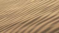 CU Wind blowing across rippled sand dune / San Pedro de Atacama, Norte Grande, Chile