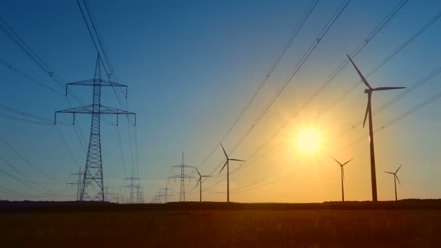 Wind energy and High Voltage Tower - sunset