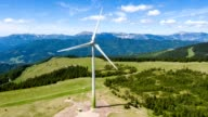 Wind turbine in the alps - aerial view - source file cinema dng