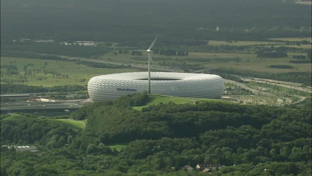 AERIAL CU Wind turbine next to Allianz Arena, Munich, Bavaria, Germany