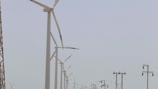 A wind turbine stands at the Suzlon Energy Ltd Nani Sindhodi wind farm in Kutch India on Saturday March 29 Wind turbines and electricity pylons low...