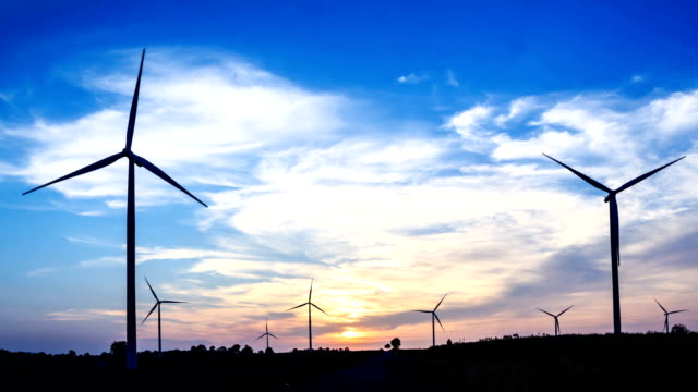 wind turbine with sunset, clean energy concept