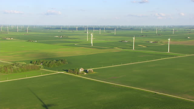 WS AERIAL POV Wind turbines in rural field / Hardin County, Iowa, United States