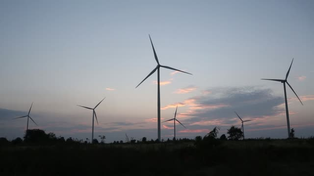 Wind turbines stand at the Subplu wind farm operated by Gunkul Engineering Pcl at dusk in Huay Bong Thailand on Thursday Nov 2 2017