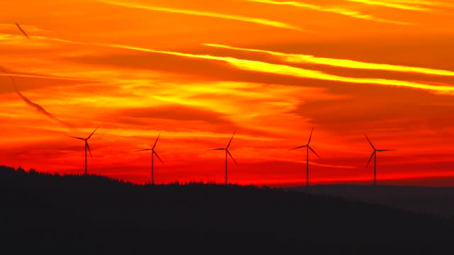 Wind turbins in morning light before sunrise