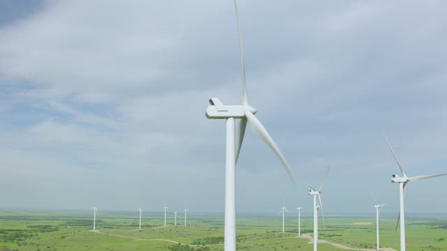 WS AERIAL Windmills spinning at Blue Canyon wind farm in Comanche county / Oklahoma, United States
