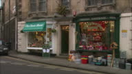 WS Window display of key cutting center and store with Christmastime decorations / Bradford on Avon, Wiltshire, United Kingdom