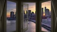 Window view New York Manhattan time lapse cityscape door sunset